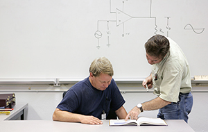 Instructor and student in a classroom setting